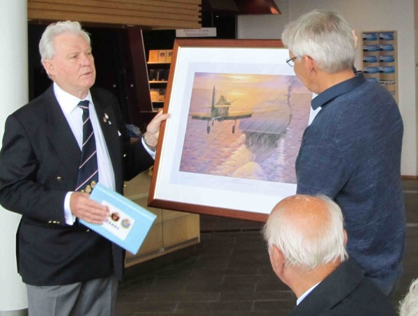 GLARAC Hon. President David Woodcock presents framed print of Sqn Leader Cross landing his Hurricane on Glorious, to The Trondenes Historical Centre.