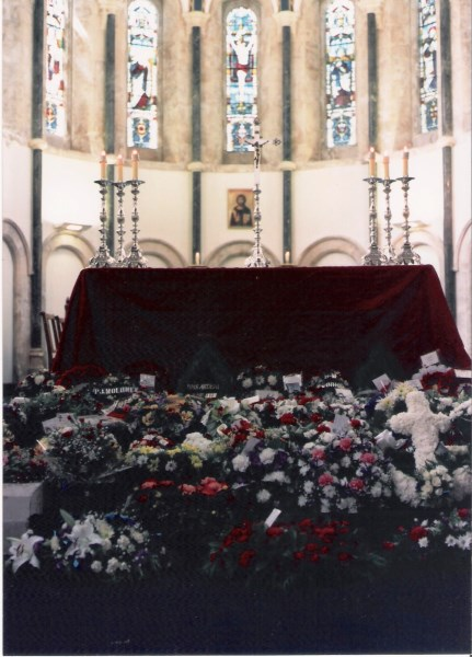 Floral tributes in front of the altar at St. Nicolas' Church following the Service of Remembrance