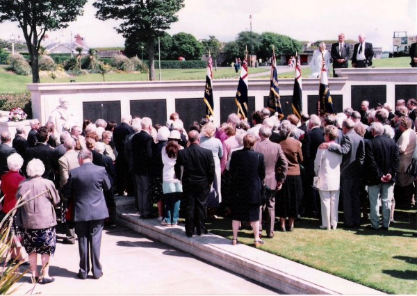 Relatives gather at the Naval Memorial on the Hoe